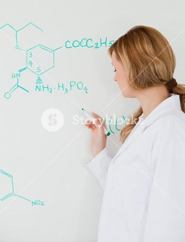 Female scientist writing a formula on a whiteboard