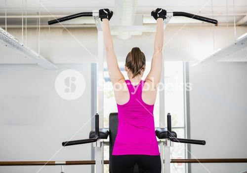 Fit woman doing pull up