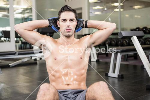 Shirtless man doing sitting up
