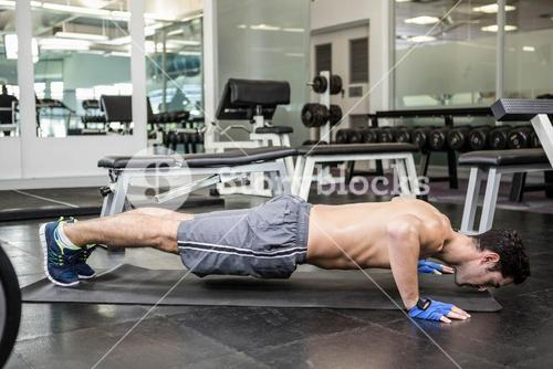 Shirtless man doing push up