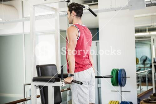 Muscular man doing pull up