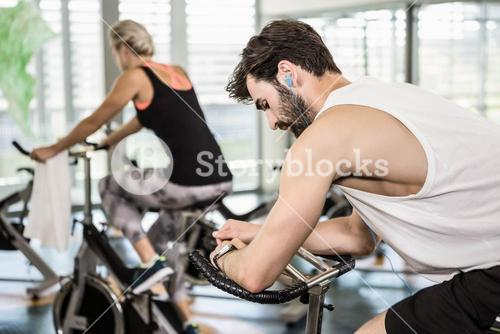 Fit couple on exercise bikes
