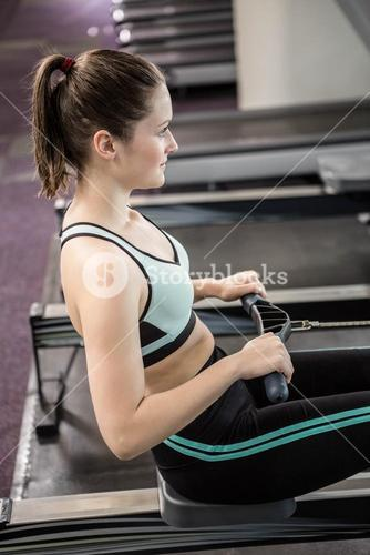 Fit brunette on drawing machine