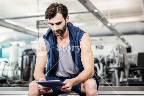 Thoughtful man using tablet