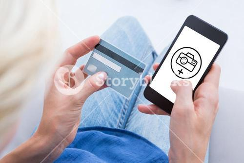 Composite image of woman doing online shopping with her mobile phone