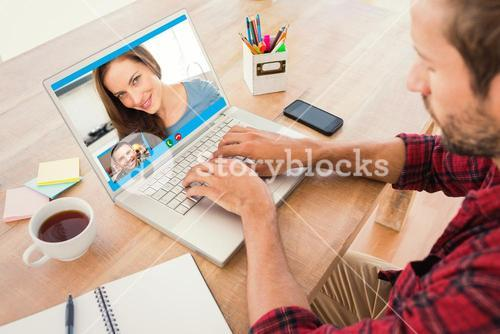 Composite image of creative businessman typing on laptop