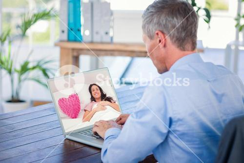 Composite image of woman lying in her bed next to a pink heart pillow