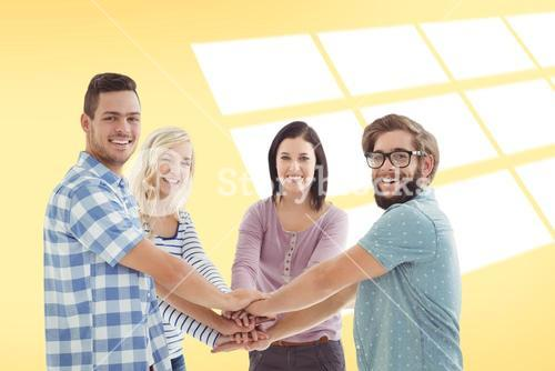Composite image of portrait of smiling business people putting their hands together