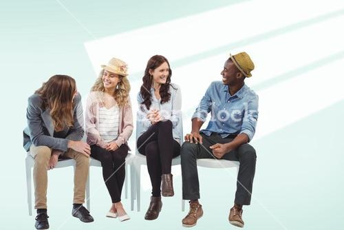 Composite image of smiling business people sitting on chair