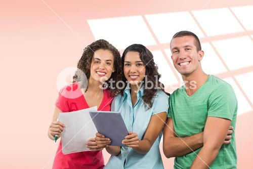 Composite image of portrait of smiling creative business people with digital tablet and document