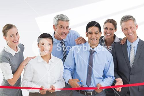 Composite image of business man cutting red strip