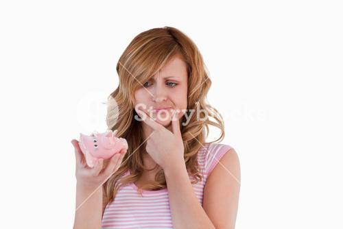Blondhaired woman confused concerning her broken piggybank