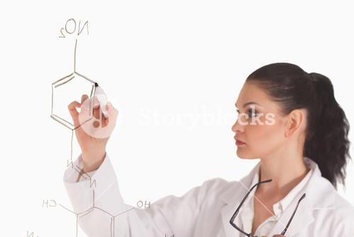 Darkhaired scientist writing a formula