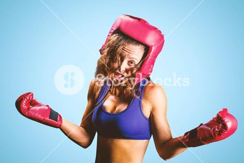 Composite image of portrait of crazy fighter with arms outstretched