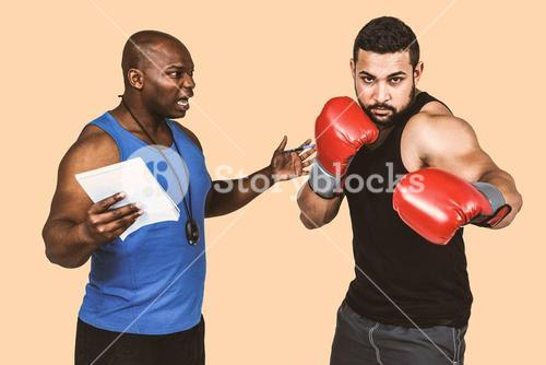 Composite image of boxing coach with his fighter
