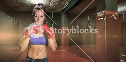 Composite image of portrait of pretty woman with fighting stance