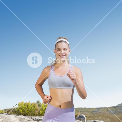 Composite image of sporty happy blonde jogging