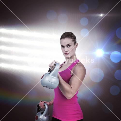 Composite image of muscular woman exercising with kettlebells