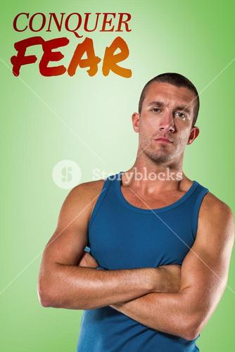 Composite image of serious athlete with arms crossed