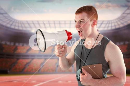 Composite image of angry personal trainer yelling through megaphone