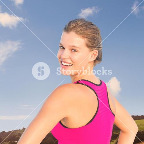 Composite image of smiling fit woman