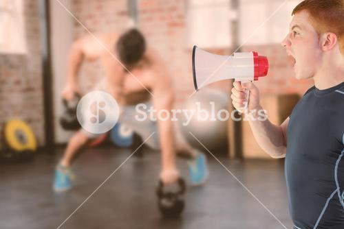 Composite image of angry rugby player yelling through the megaphone