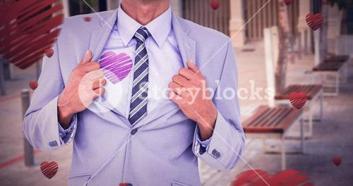 Composite image of midsection of businessman opening shirt like superhero