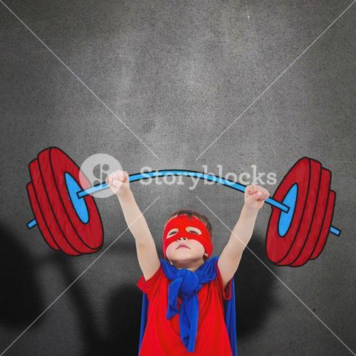 Composite image of little boy holding dumbbell