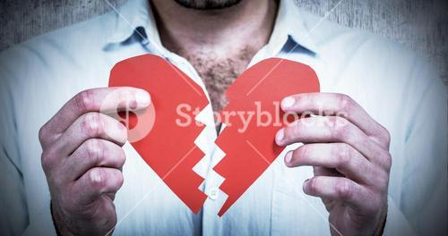 Composite image of sad man holding heart halves