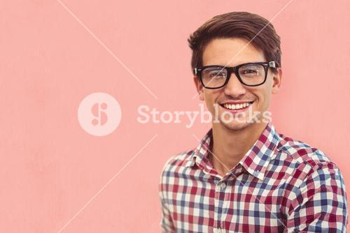 Composite image of young businessman smiling
