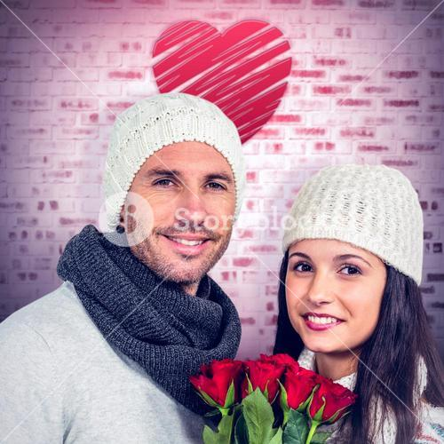 Composite image of smiling couple holding roses bouquet