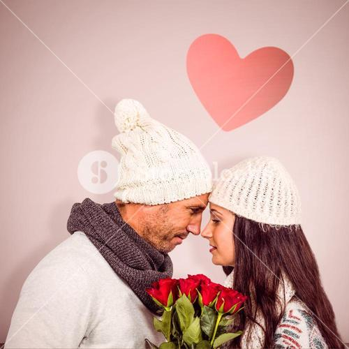 Composite image of smiling couple nose-to-nose holding roses bouquet