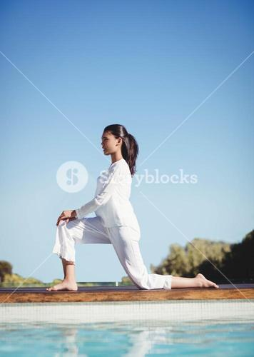 Calm brunette doing yoga