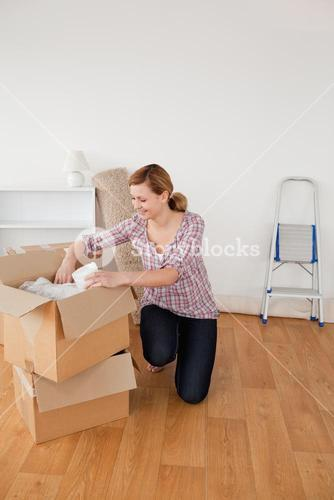 Beautiful blondhaired woman preparing to move house