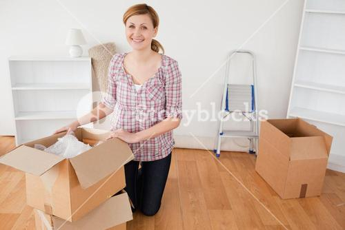 Young blondhaired woman preparing to move house