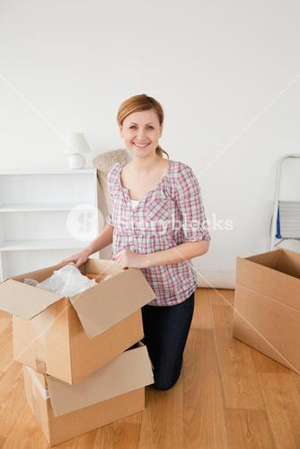 Smiling blondhaired woman preparing to move house