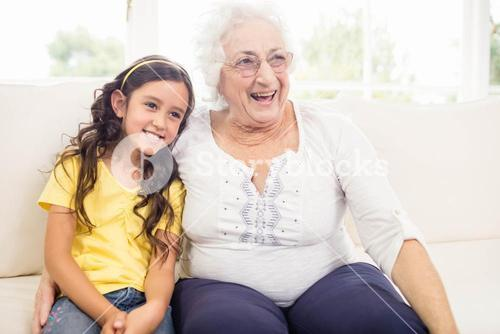 Happy grandmother and granddaughter smiling