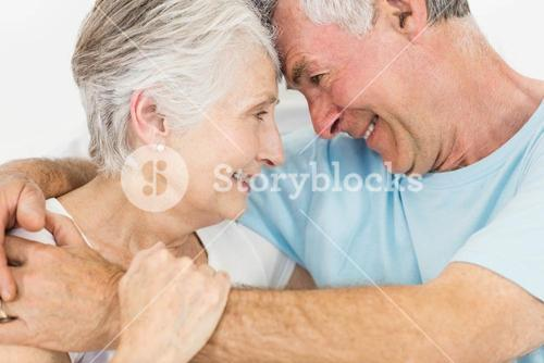 Smiling senior couple face to face