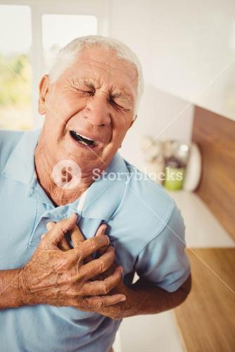 Painful senior man with pain on heart