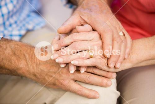 Senior couples hands together