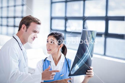 Medical team looking at x-ray together