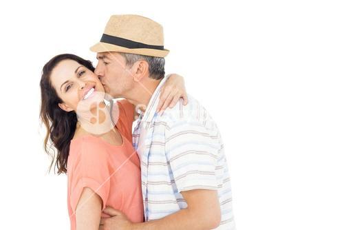 Husband kissing his wife on the cheek