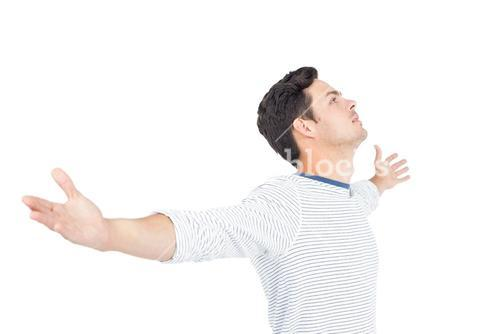 Thoughtful man with arm open