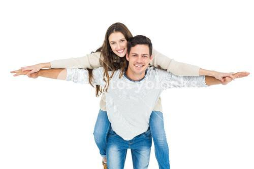 Man giving piggy back to his girlfriend