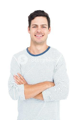 Smiling man with arm crossed