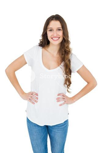 Smiling woman with hands on hips