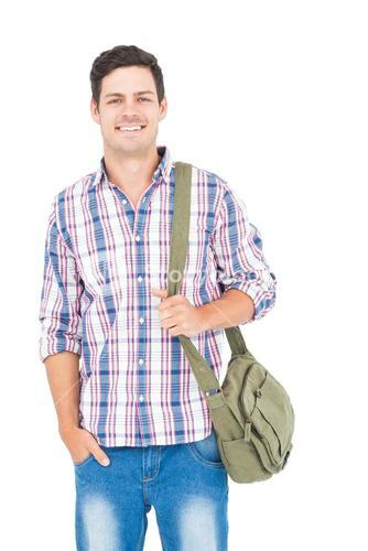 Portrait of smiling male student with a school bag