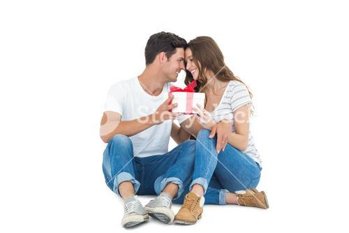 Happy couple receiving a gift