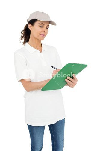 Delivery woman signing a clipboard