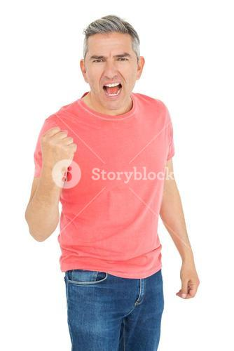Excited man shouting with fist up